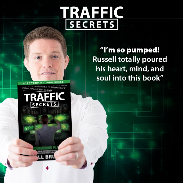 Russell Brunson with Traffic Secrets Book -